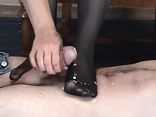 Soccer Milf pantyhose stocking foot job jerks cum load on feet in nylons