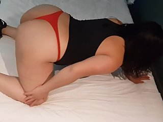 Big butt latina in red thong shows her booty