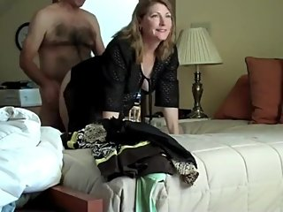 Amateur wife with her boss on business trip in hotel room