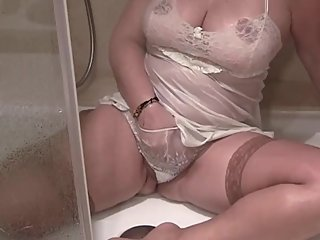 Hot Milf Striptease in Hotel for her husband to watch from home!