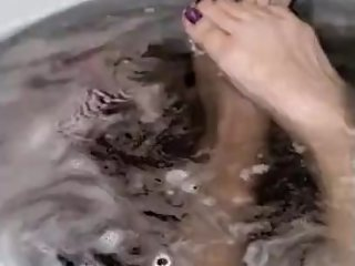 long tootsies taking a bath