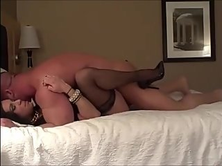 Milf in stockings and high heels fucked in hotel room