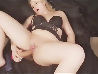 Camgirl playing with her big dildo.