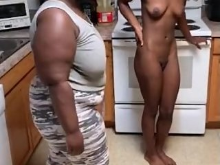 Ebony girl gets tied up and then gets spanked bending over stove