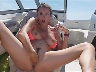Nice MILF masturbation on boat !