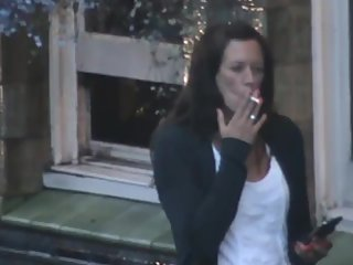 Gorgeous milf smoking outside pub