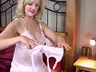 Slipping into a Satin Slip with Satin Panties on Satin Sheets