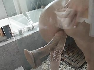 In my Shower Riding a mounted dildo deep in my round ass.