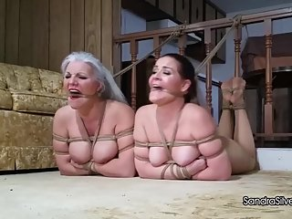 2188 Hogtied Pantyhose MILF Captives with Feet and Mouths Roped to Railing!