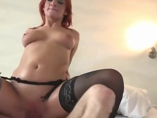 Stunning redhead MILF has a suprise